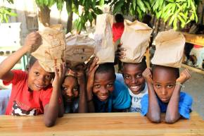 Would Aristotle's view of happiness have changed if he went on a mission trip toHaiti?