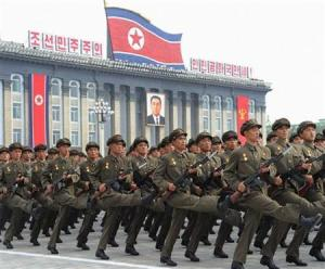 North Korean soldiers parade in front a portrait of former North Korean President Kim Il-sung during a military parade in Pyongyang